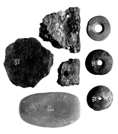 Postcard of Spindle whorls, pottery sherds, hammerstone and blank from Coalhill, near Dalry, Ayrshire.