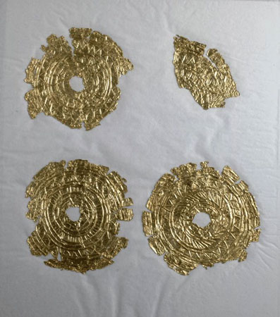Postcard of Fragments of gold discs.