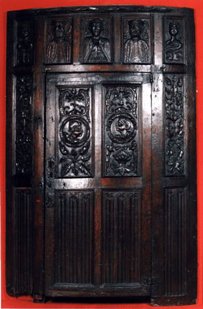 Postcard of Door of carved oak.