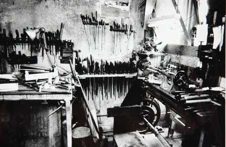 Postcard of Interior of J. and R. Glen, Highland Bagpipe Makers.