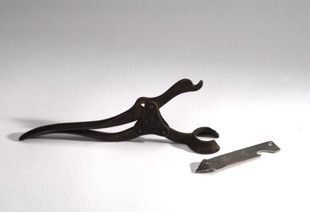Postcard of Bottle opener & bottle and can opener.