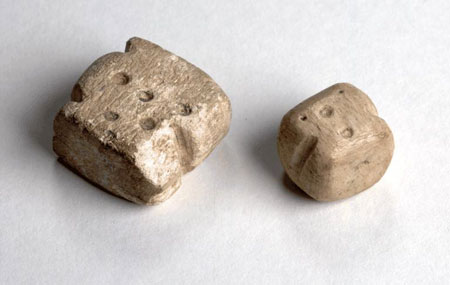 Postcard of Two bone dice.