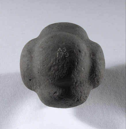 Postcard of Carved stone ball.