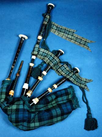 Postcard of Full size set of Highland bagpipes known as MacCorquodale's Pipes.